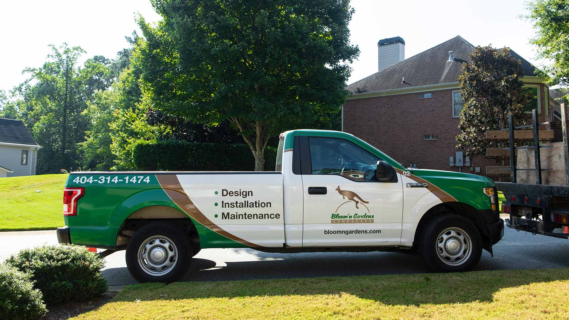A Bloom'n Gardens Landscape work truck after completing a landscaping project in Atlanta, GA.