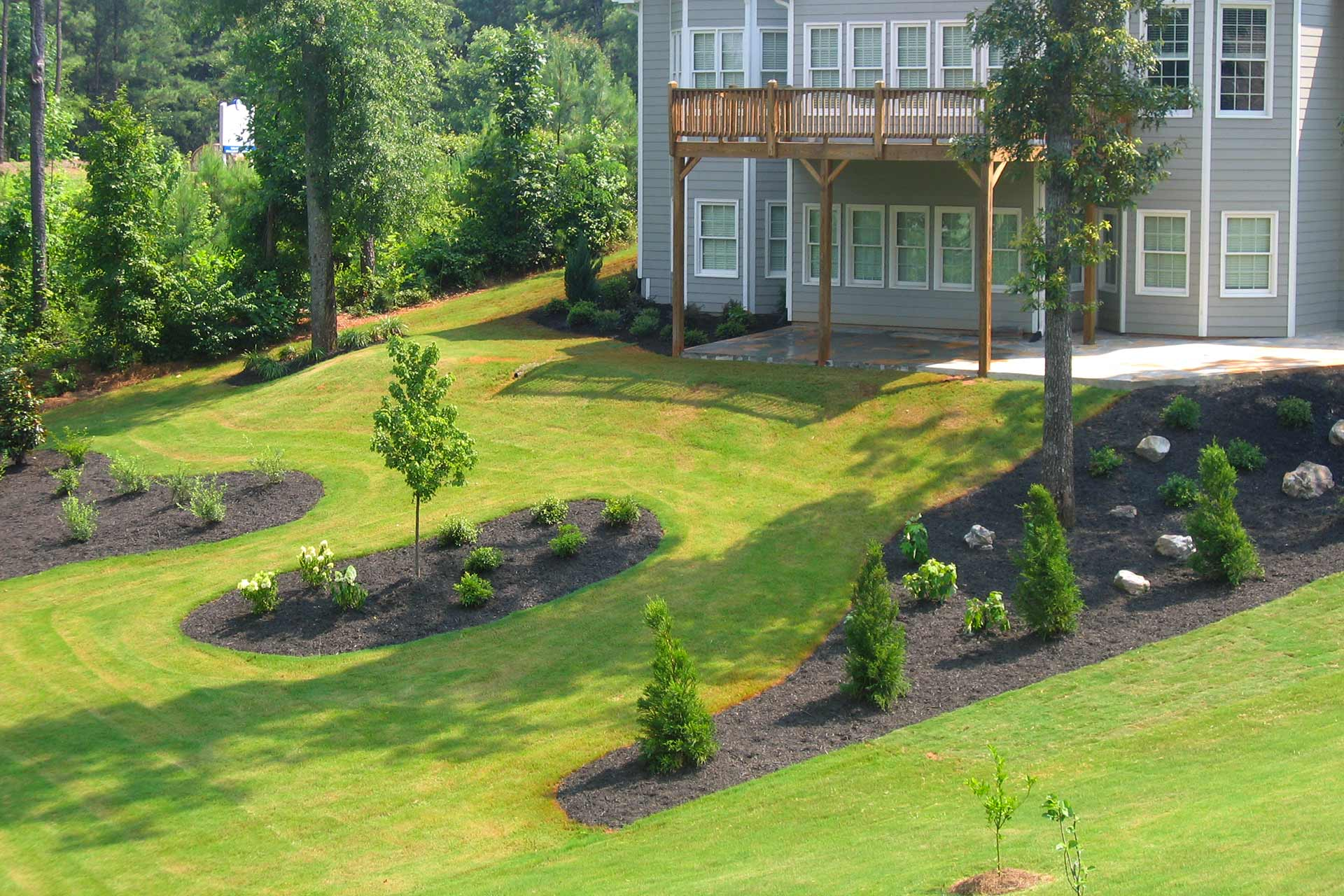 Elevated landscaping and mulch beds at a home property in Buckhead, GA.