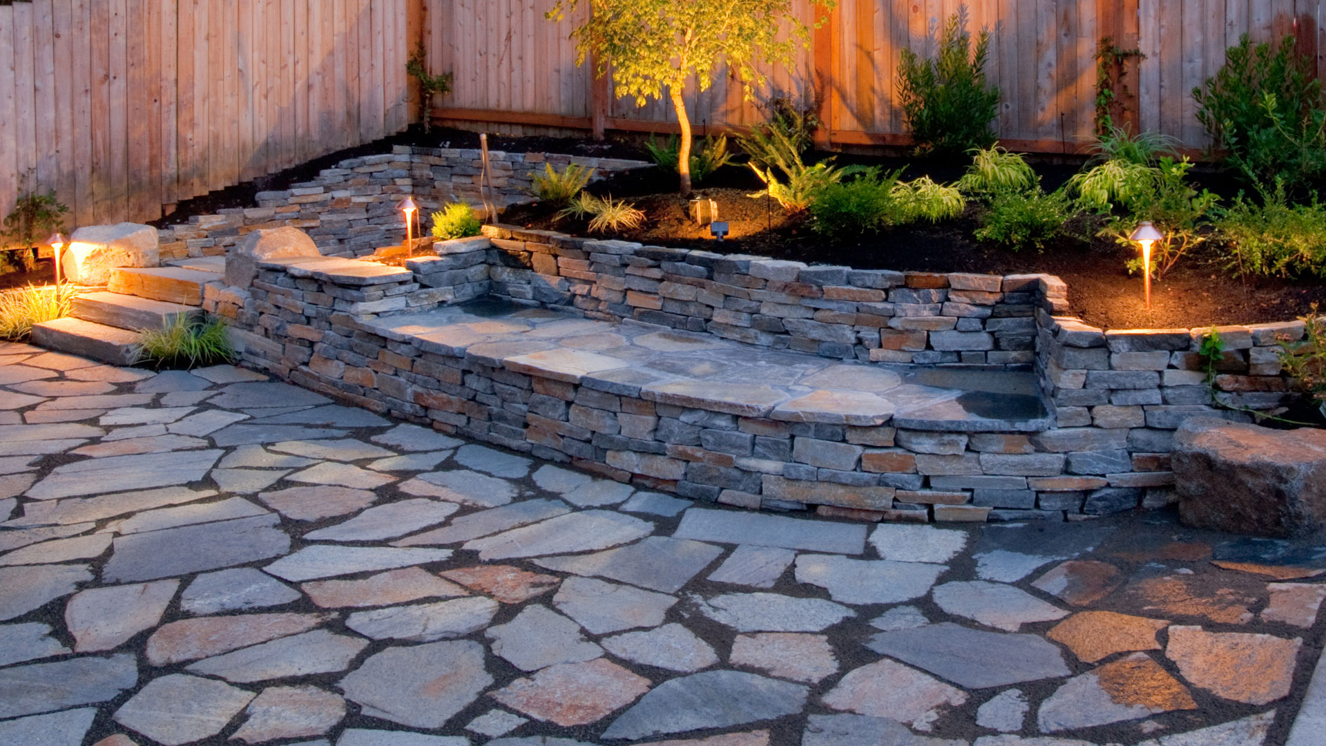 Landscape lighting highlighting a recently installed hardscape and softscape project.
