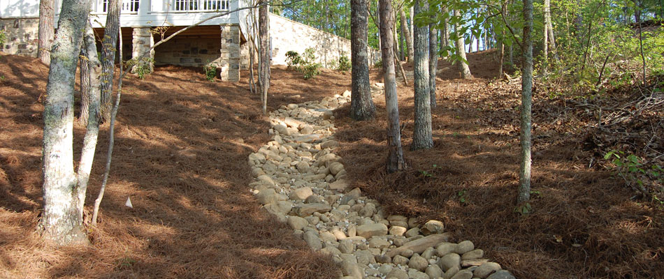 A dry creek bed used for drainage installed at a home in Buckhead, GA.