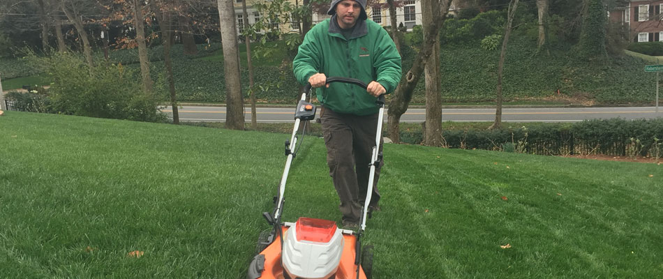 One of our employees mowing a property in Buckhead, GA.