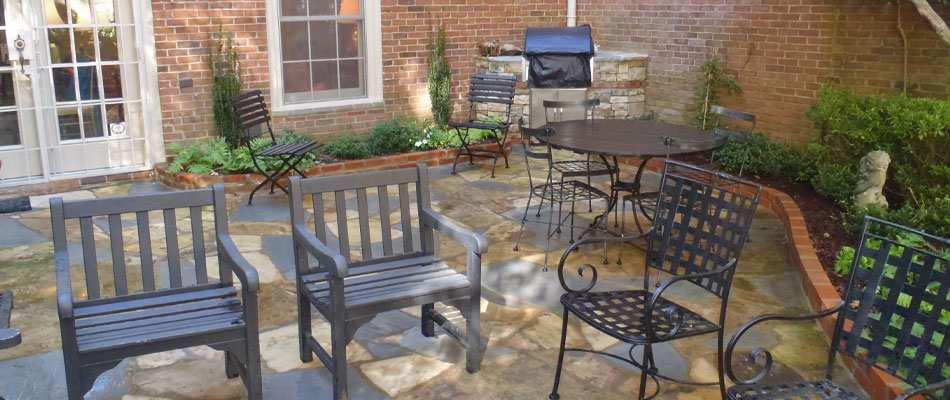 Flagstone paver patio installed in an outdoor living space.